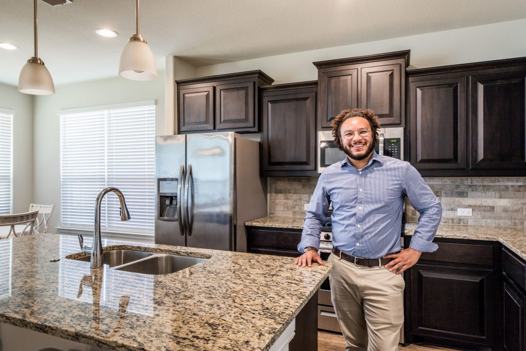 real estate agent standing in kitchen